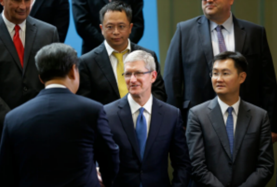 President Xi Jinping of China, lower left, greeting Apple's chief executive, Tim Cook, in 2015. Mr. Cook has made frequent, statesmanlike visits to China. Associated Press