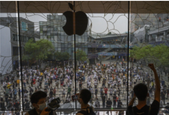People waiting in line last year for the opening of a new Apple Store in Beijing. The company earns a fifth of its revenue in the China region. Kevin Frayer/Getty Images